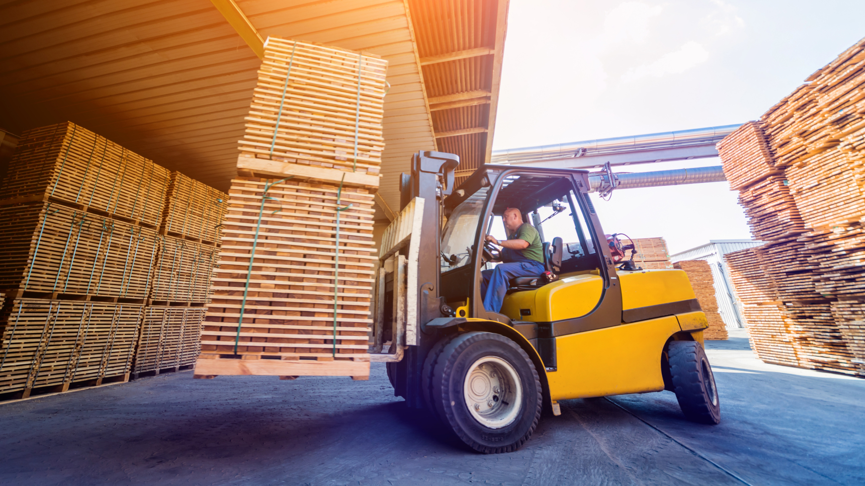 A Forklift Driving and Stacking Pallets in a Warehouse