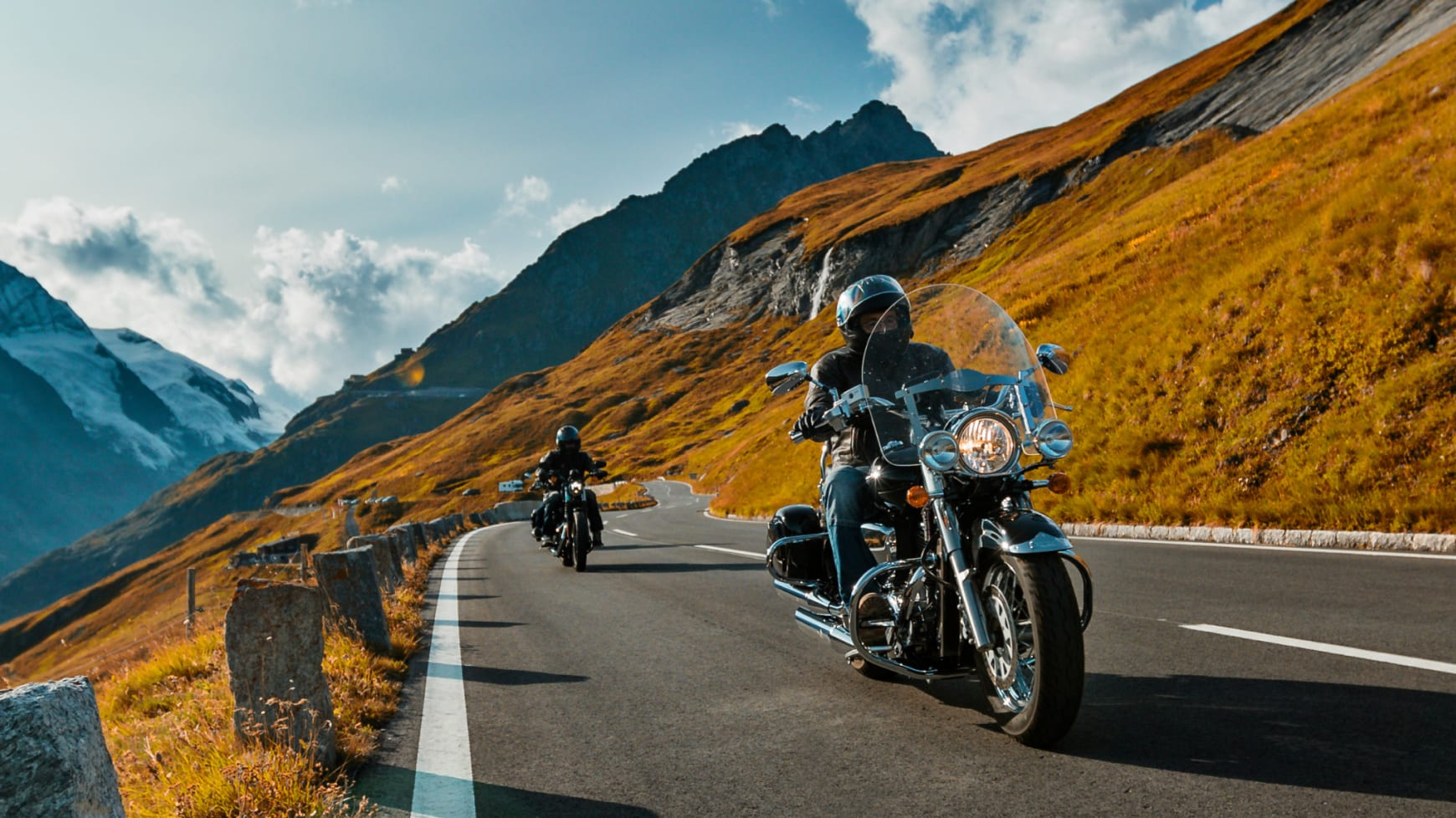 Two Motorcycles Driving On a Mountain Road