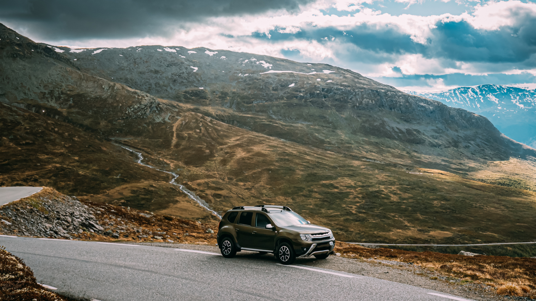 SUV Parked on a Mountain Side