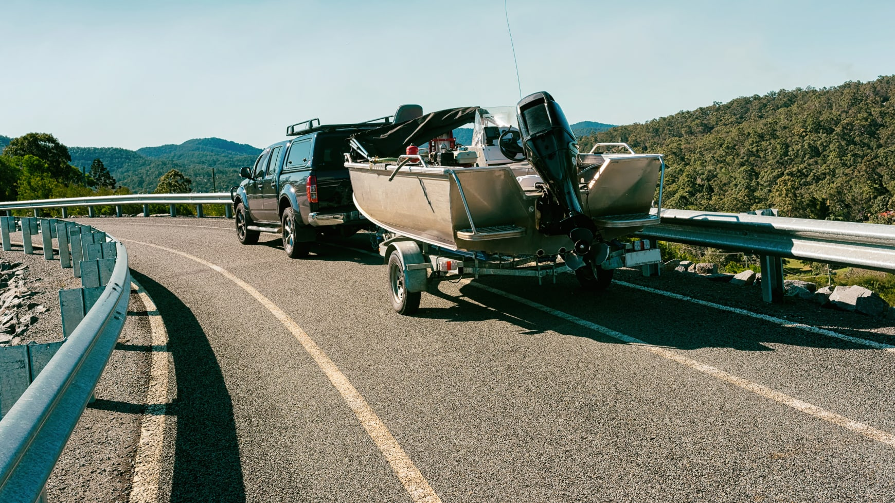 A Pickup Truck Towing a Boat on a Trailer