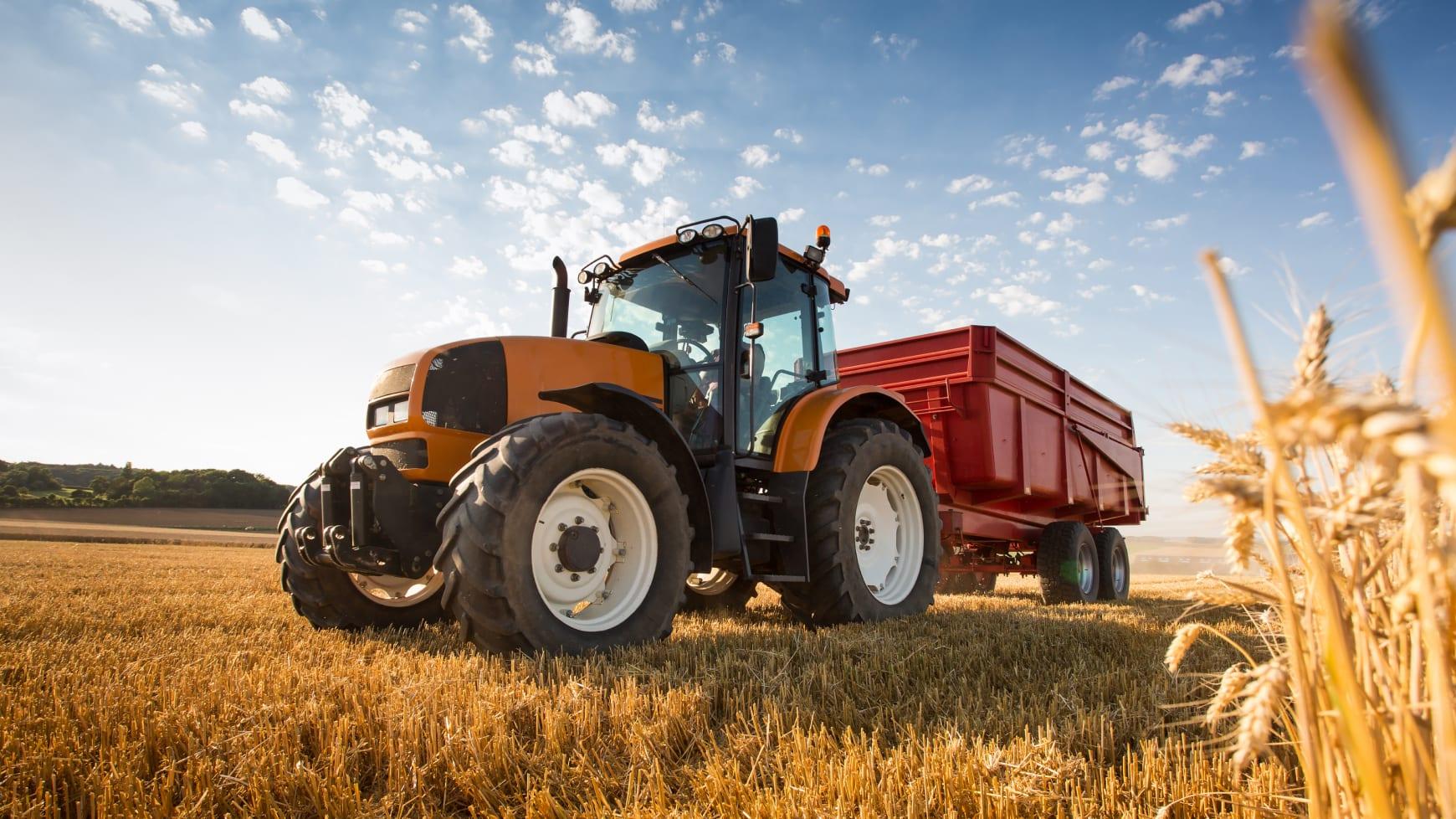 Farming Tractor Driving Through Crops