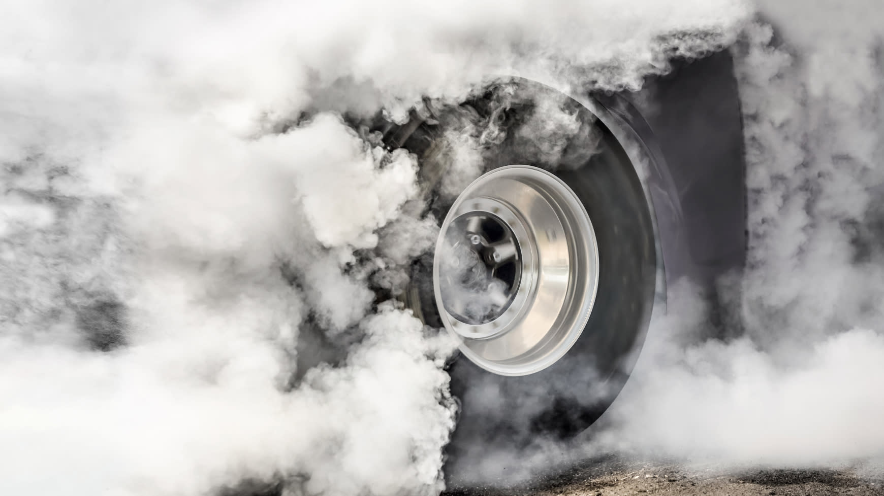 A Drag Racer Doing a Burnout on the Track
