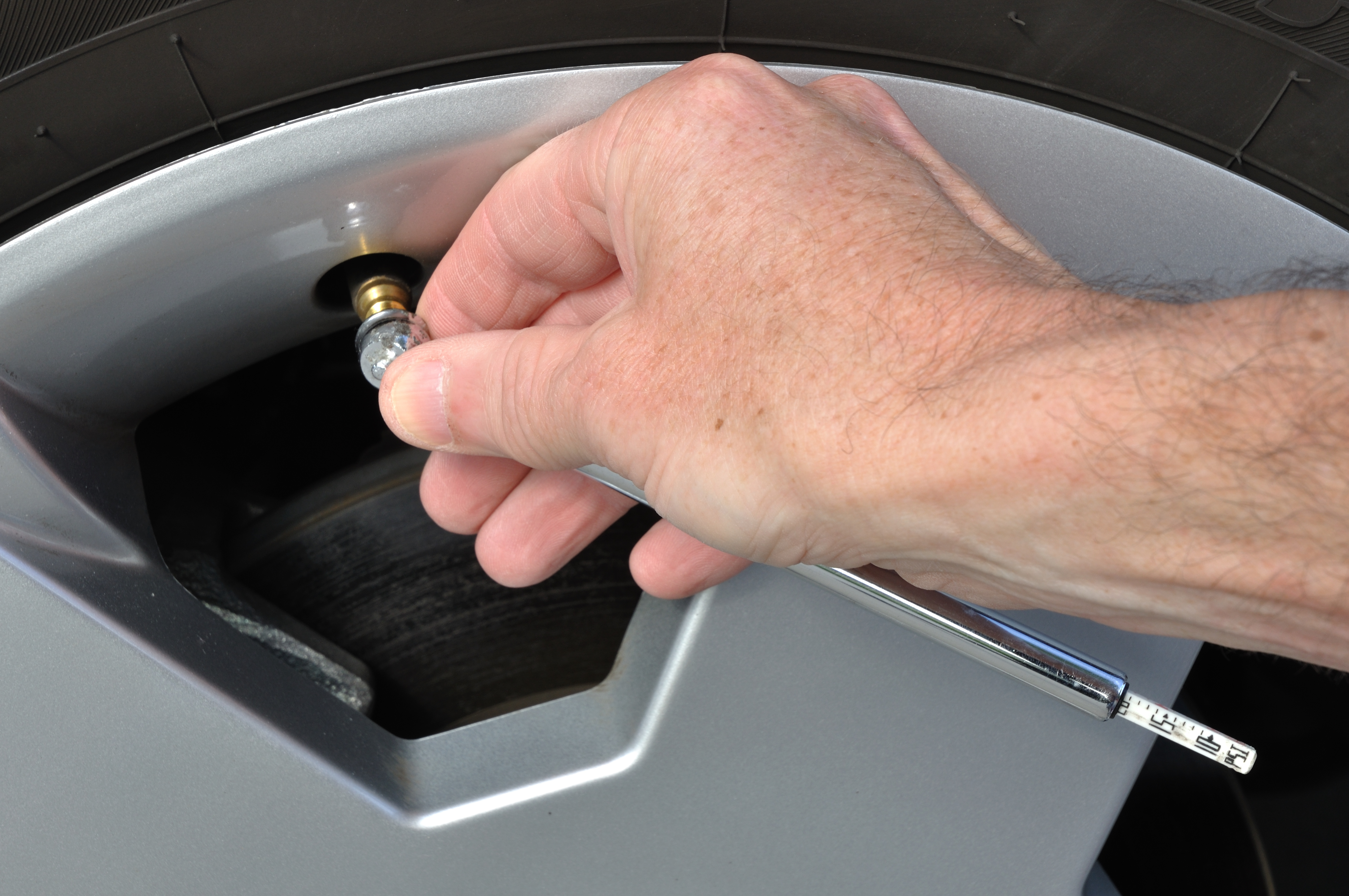 Checking Tire Pressure With a Tire Pressure Gauge