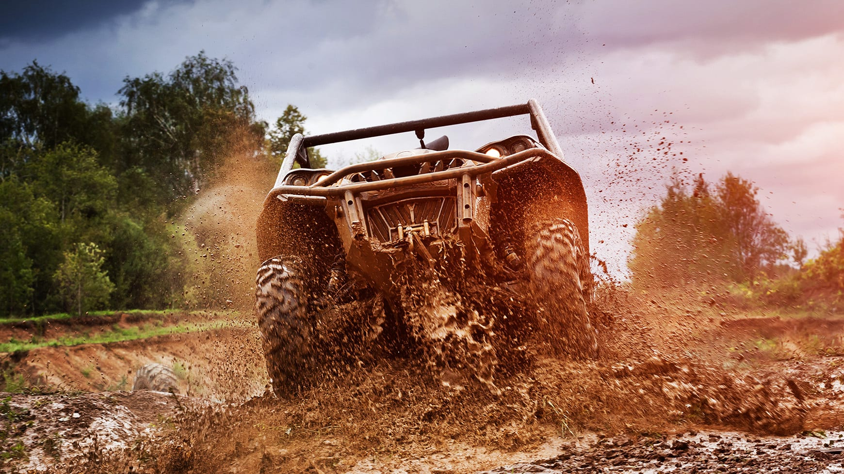 ATV Driving Through Mud Equipped with Mud Tires