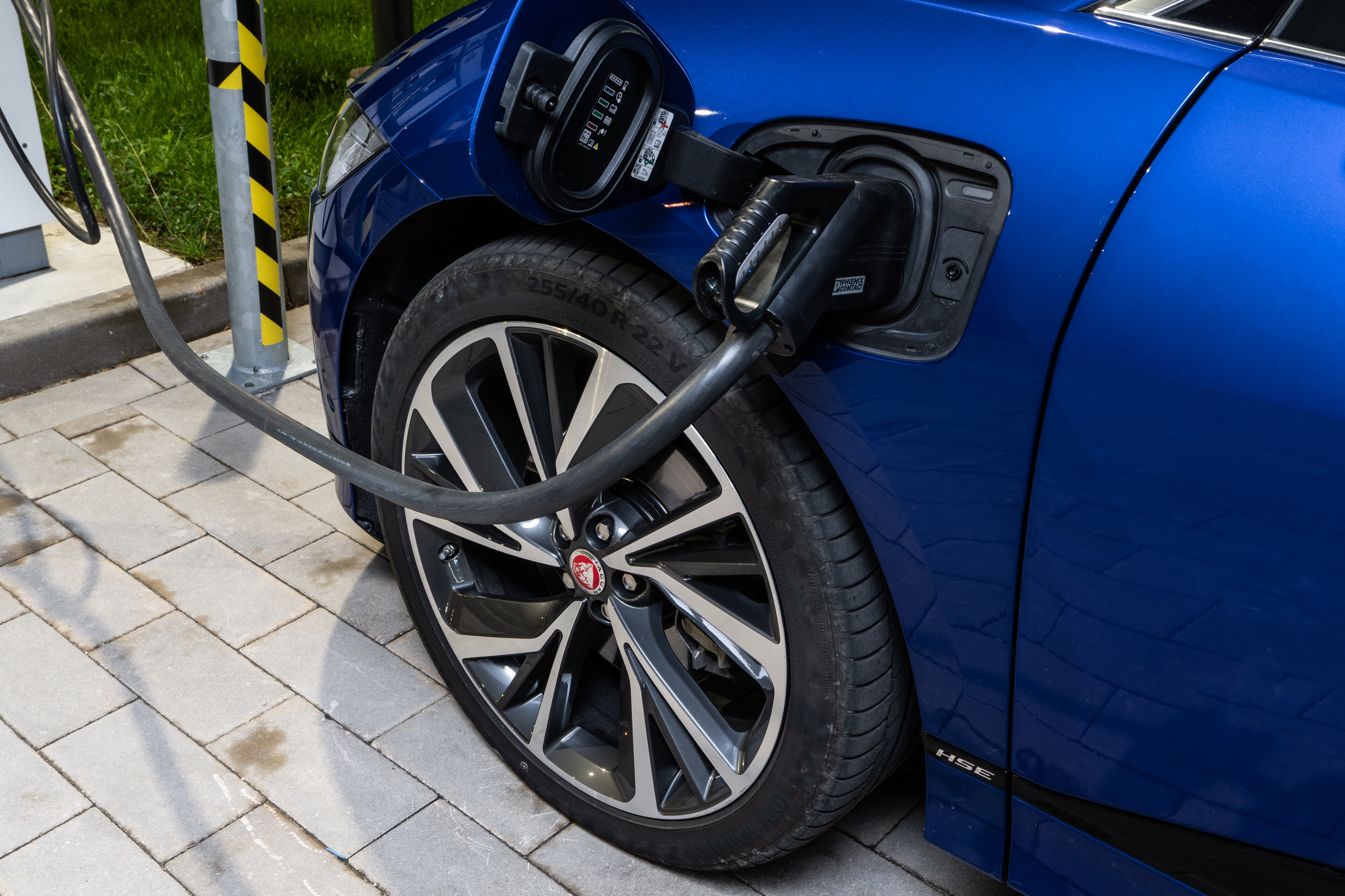 Blue Jaguar I-Pace Compact Luxury Electric CUV Plugged Into Electric Charger
