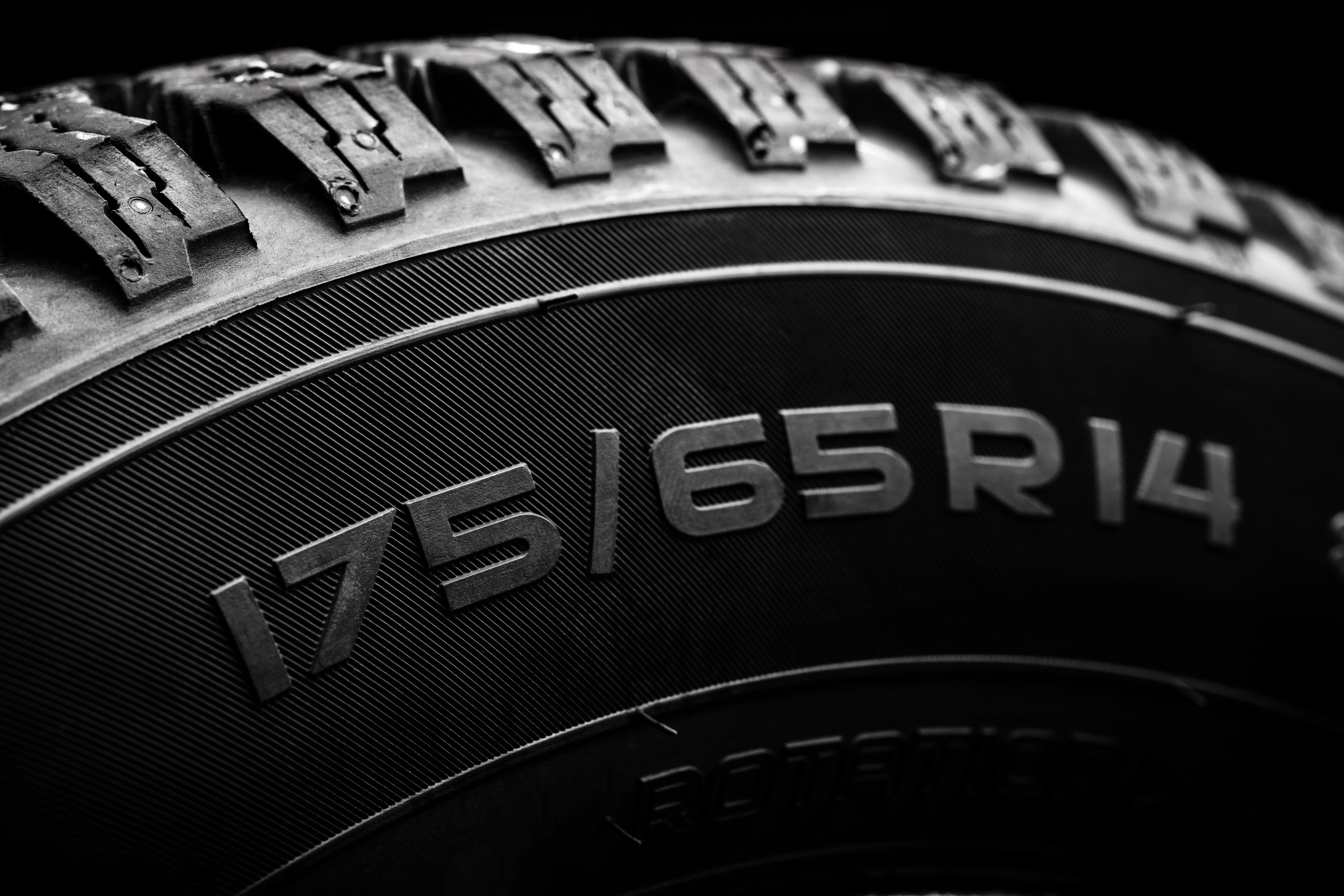 Close up of tire size markings and tread