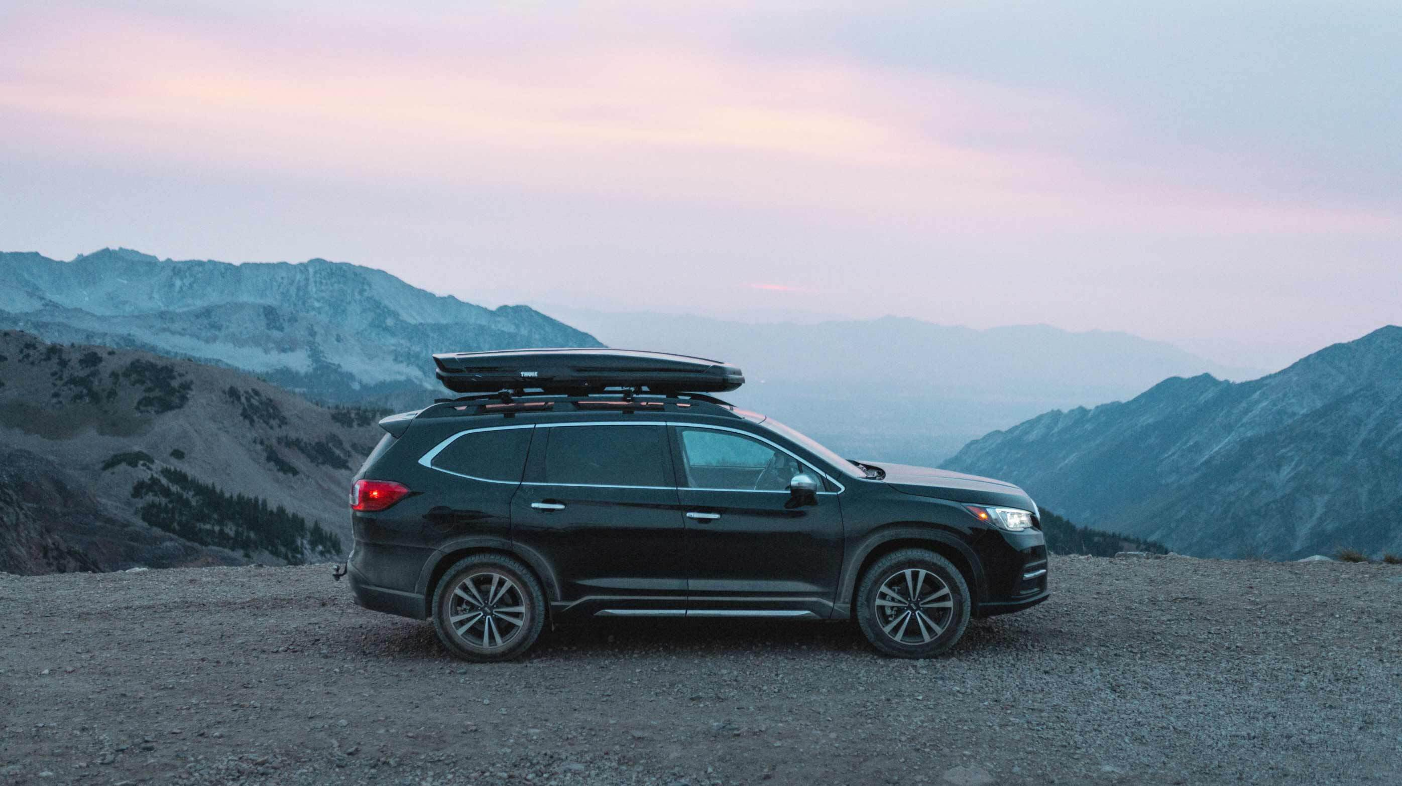 Black SUV equipped with Nokian One tires sitting on the top of a mountain
